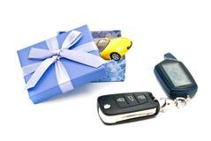 Car keys, sport car and blue gift box Stock Image