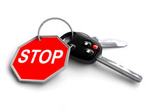 Car keys with stop road sign on keyring. Royalty Free Stock Photos