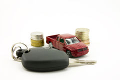 Car keys and toy car  and money. Car keys and toy car and money   isolated on white background Royalty Free Stock Image
