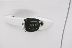 Car keys in white door lock closeup with copy space Stock Photography