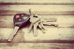 Car Keys. On wood background , Old and Used vintage style stock image