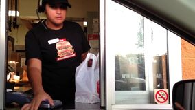 Car in KFC drive through for picking up order stock footage