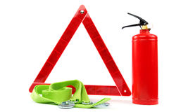 Car kit. Fire extinguisher, emergency sign and tow rope Royalty Free Stock Photography