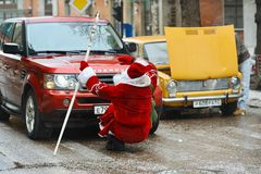 Car knocked Santa Claus stock images
