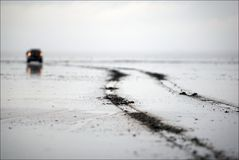 The car on lake. A leaving trace from protectors of wheels also leaves afar Stock Images