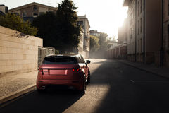Car Land Rover Range Rover Evoque standing on asphalt road in city Moscow at sunset Stock Photos