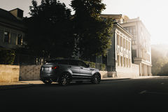 Car Land Rover Range Rover Evoque standing on asphalt road in city Moscow at sunset Royalty Free Stock Images