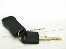 Car lease. Car keys on a lease agreement Royalty Free Stock Photo