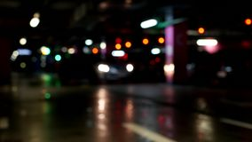 The car leaves the underground car park, blurred. Traffic stock footage