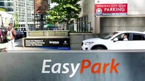 Car leaving easy park entrance stock video