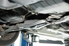 Car on lift in automobile repair service. Garage stock image