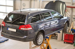 Car on lift. Royalty Free Stock Image