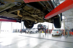 Car on the lift in the service center. Royalty Free Stock Photography