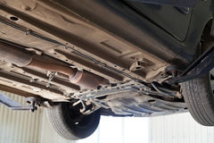 Car lifted on auto hoist at service station Royalty Free Stock Photography