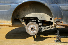 Car Lifted On Jack to Change Tire Royalty Free Stock Photos