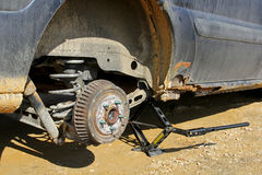 Car Lifted On Jack to Change Tire Stock Photography