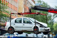 Car is lifted for loading on the tow truck royalty free stock photography