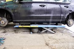 The car lifted by a pneumatic jack, wheel replacement.  stock image