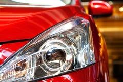 Car light. The red sports car's headlights Stock Photos