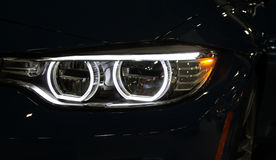 Car light close-up. Car front light glow close-up Royalty Free Stock Images
