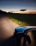 Car Light in Darkness Stock Images