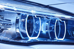 Car light detail in blue tone Vehicle part. Vertical. Car light detail in blue tone. Vehicle part. Vertical format stock photography