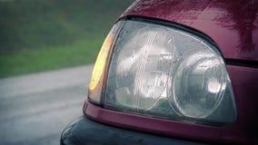 Car Light Flashing As Cars Pass In Rain stock video footage