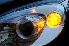 Car light headlight. A xenon car light with blinking turn indicator stock image