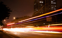 Car light in motion. Car running fast leaving light in motion in the urban scene Royalty Free Stock Images
