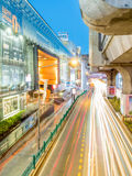 Car light movement in Bangkok. BANGKOK - AUGUST 8: Movement of car light on traffic road at Siam Square shopping center in Bangkok under twilight evening sky Royalty Free Stock Image