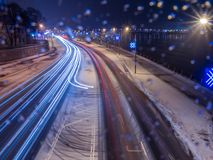 Car light at night on ice road in snow winter Royalty Free Stock Photos