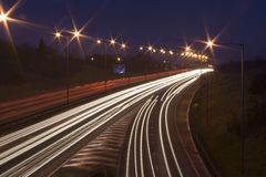 Car light rails on the M1 in England, UK. Traffic light on England's longest motorway at dusk royalty free stock images