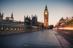 Car light streaks and ghosts of people near big ben Royalty Free Stock Images