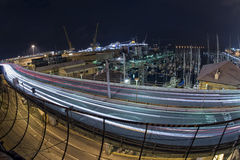 Car light tracks on Genoa Flyover at night Stock Photography