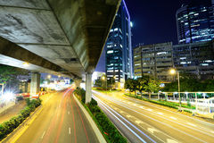 Car light trail and urban landscape Stock Photography