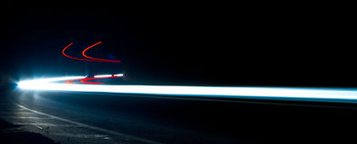 Car light trails. Art image . Long exposure photo taken in a tun Royalty Free Stock Photo