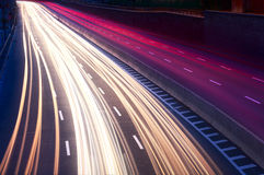 Car light trails on the city street at night Stock Photos