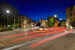 Car light trails on the crossroad during night in the city of Um. Bertide, Italy stock images