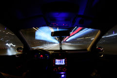 Car light trails, driver inside Royalty Free Stock Photos