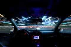 Car light trails, driver inside Royalty Free Stock Image