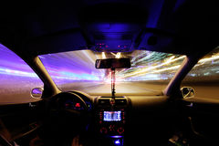 Car light trails, driver inside Stock Photo