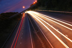 Car light trails on motorway Stock Images