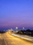Car light trails on motorway with beautiful skyscape at twilight Royalty Free Stock Image