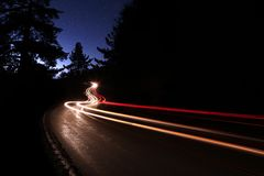 Car Light Trails in the Mountains on a Starry Nigh Stock Photo