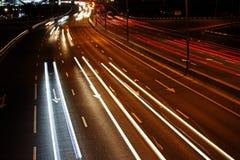 Car light trails at night Stock Photos