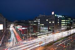 Car light trails at night in Vienna royalty free stock image