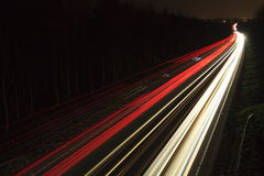 Car light trails. Light trails on the A5 trunk road near Chirk Stock Images