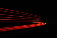 Car light trails in the tunnel. Stock Photos