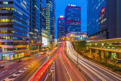 Car light trails and urban landscape in Hong Kong. Stock Images