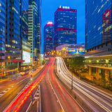 Car light trails and urban landscape in Hong Kong. Stock Image